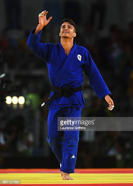 Fabio Basile of Italy celebrates winning the gold medal against Baul An of Korea during the Men's 66kg gold medal final on Day 2 of the Rio 2016...