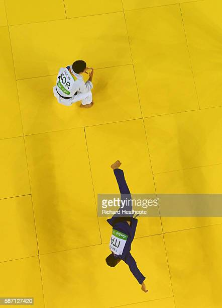 Fabio Basile of Italy performs a flip as he celebrates winning the gold medal against Baul An of Korea during the Men's 66kg gold medal final on Day...