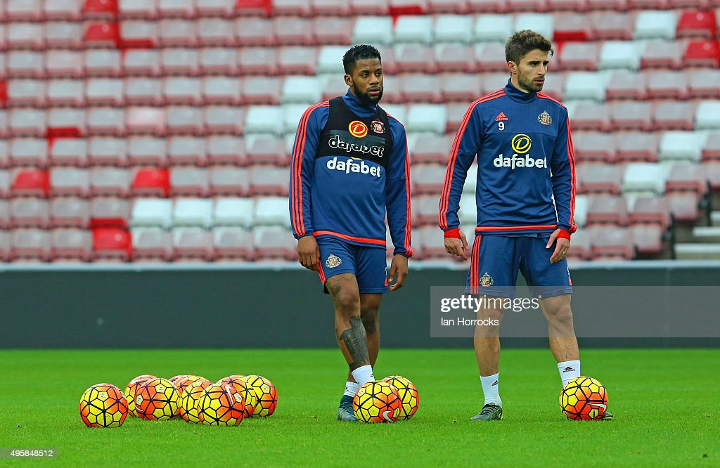 Fabio Borini (R) and Jeremain Lens look on during a Sunderland training session at the Stadium of Light on November 05, 2015 in Sunderland, England.