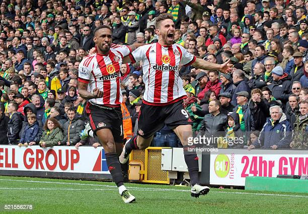Fabio Borini and Jermain Defoe of Sunderland celebrate the second goal during the Barclays Premier League match between Norwich City and Sunderland...