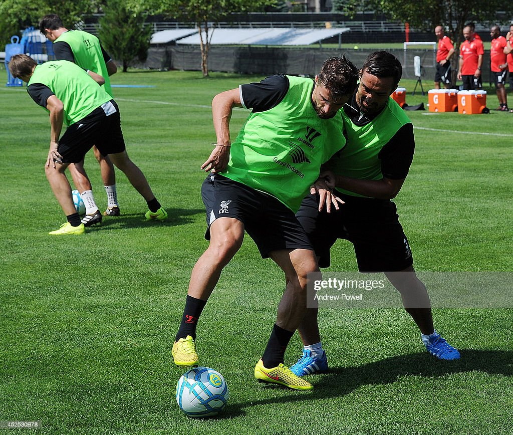 Fabio Borini and Jose Enrique of Liverpool in action during a training session at Harvard University on July 22, 2014 in Cambridge, Massachusetts.