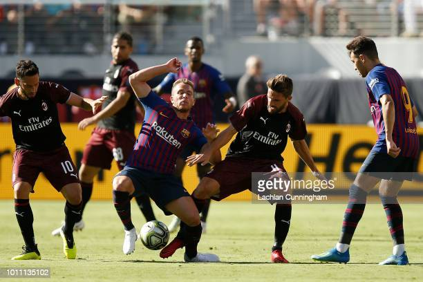 Fabio Borini of AC Milan and Arthur Melo of FC Barcelona compete for the ball during the International Champions Cup match at Levi's Stadium on...