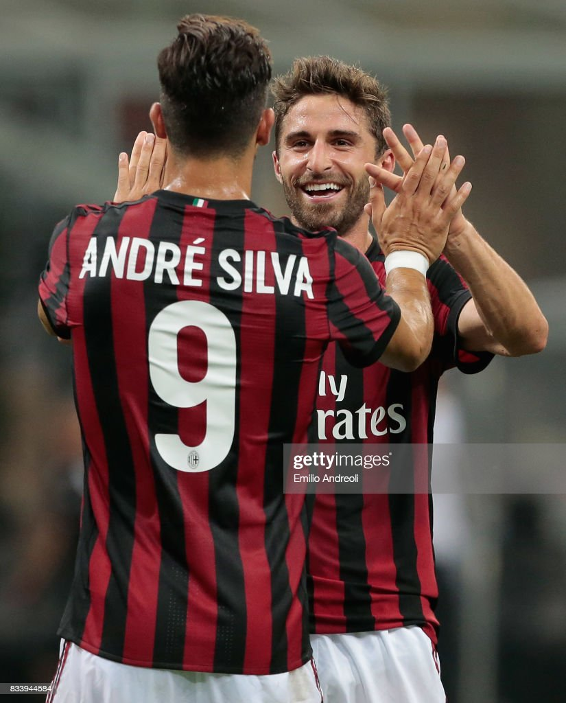 Fabio Borini of AC Milan (R) celebrates his goal with his team-mate Andre Silva during the UEFA Europa League Qualifying Play-Offs round first leg match between AC Milan and KF Shkendija 79 at Stadio Giuseppe Meazza on August 17, 2017 in Milan, Italy.