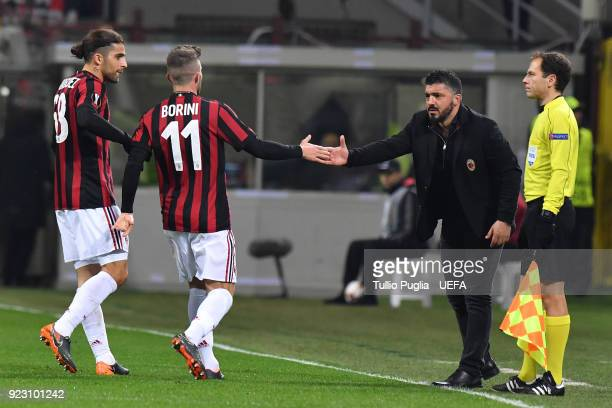 Fabio Borini of AC Milan celebrates with head coach Gennaro Gattuso after scoring the opening goal during UEFA Europa League Round of 32 match...