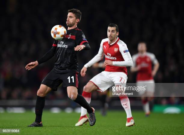 Fabio Borini of AC Milan controls the ball in front of Henrikh Mkhitaryan of Arsenal during the UEFA Europa League Round of 16 Second Leg match...