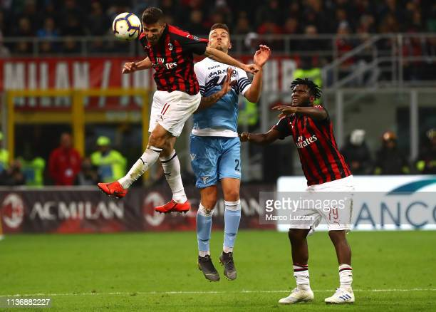 Fabio Borini of AC Milan is challenged by Sergej MilinkovicSavic of SS Lazio during the Serie A match between AC Milan and SS Lazio at Stadio...