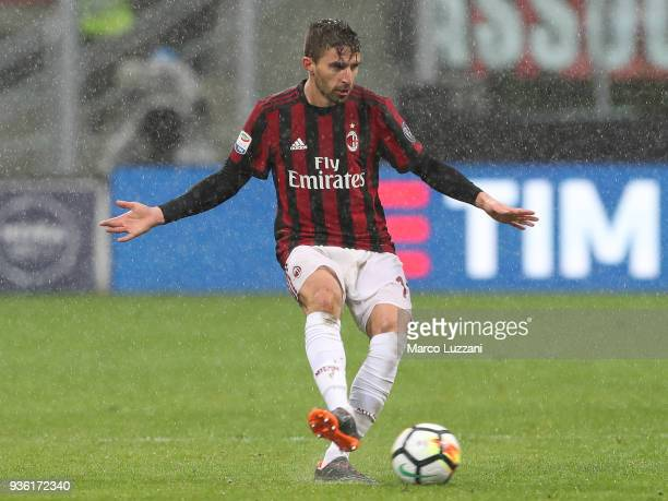 Fabio Borini of AC Milan kicks the ball during the serie A match between AC Milan and AC Chievo Verona at Stadio Giuseppe Meazza on March 18 2018 in...