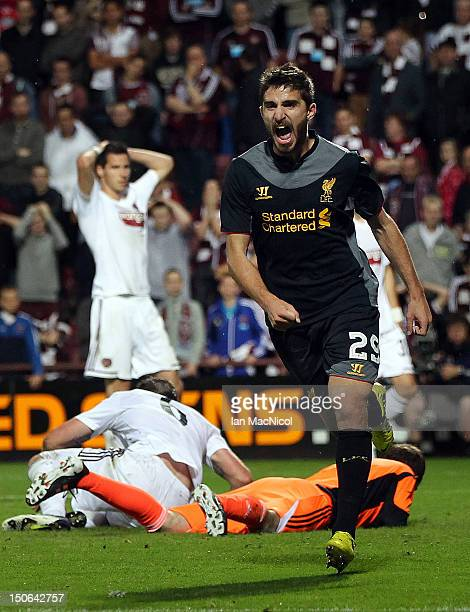 Fabio Borini of Liverpool celebrates after Andrew Webster of Hearts scored an own goal during UEFA Europa League play-off first leg match between...
