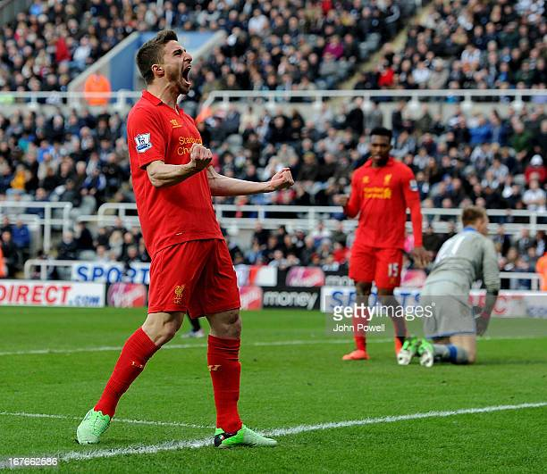 Fabio Borini of Liverpool celebrates after scoring the fifth goal during the Barclays Premier League match between Newcastle United and Liverpool at...