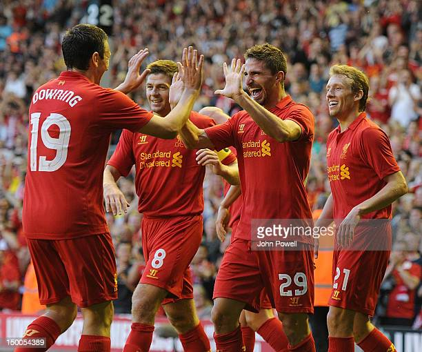 Fabio Borini of Liverpool celebrates his goal with team mates during the UEFA Europa League Third Round Qualifier between Liverpool and Gomel at...