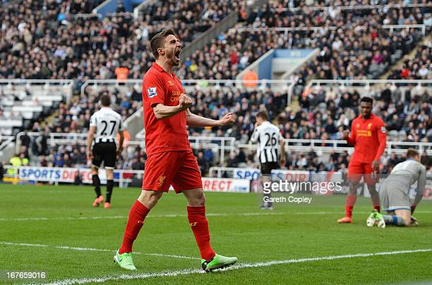 Fabio Borini of Liverpool celebrates scoring the fifth Liverpool goal during the Barclays Premier League match between Newcastle United and Liverpool...