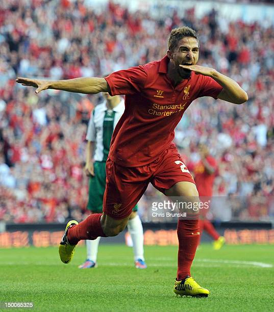 Fabio Borini of Liverpool celebrates scoring the opening goal during the UEFA Europa League Third Round Qualifier between Liverpool and Gomel at...