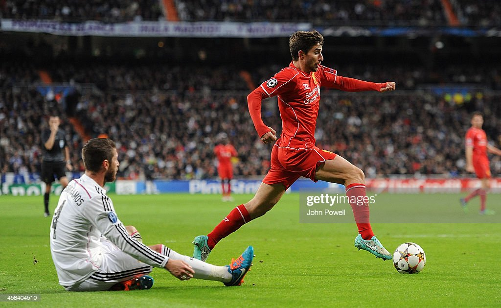Fabio Borini of Liverpool competes with Sergio Ramos of Real Madrid CF during the UEFA Champions League Group B match between Real Madrid CF and Liverpool FC on November 4, 2014 in Madrid, Spain.