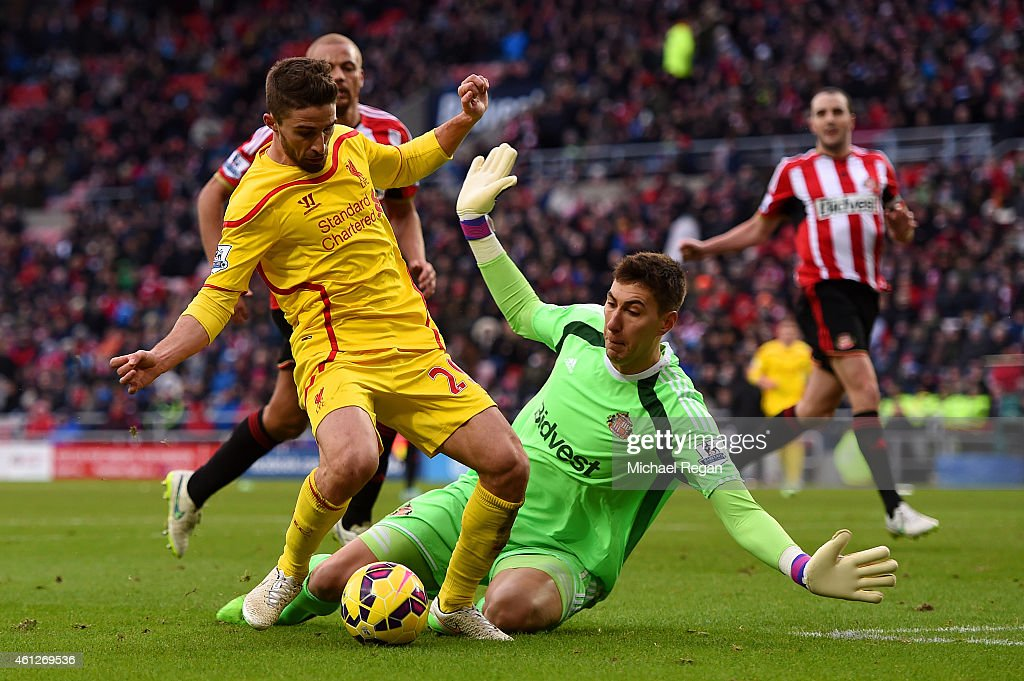 Fabio Borini of Liverpool rounds Costel Pantilimon of Sunderland but fails to score during the Barclays Premier League match between Sunderland and Liverpool at Stadium of Light on January 10, 2015 in Sunderland, England.