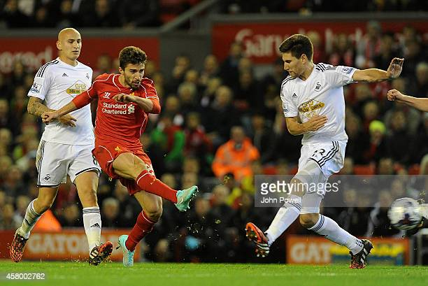 Fabio Borini of Liverpool tries a shot during the Capital One Cup Fourth Round match between Liverpool and Swansea City at Anfield on October 28 2014...