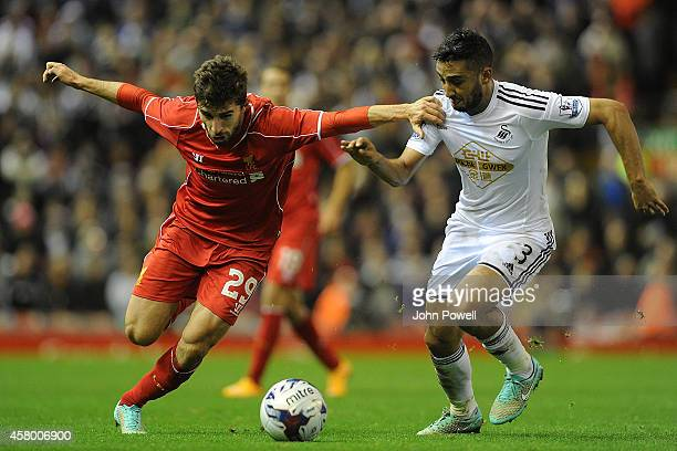 Fabio Borini of Liverpool tussles with Neil Taylor of Swansea City during the Capital One Cup Fourth Round match between Liverpool and Swansea City...