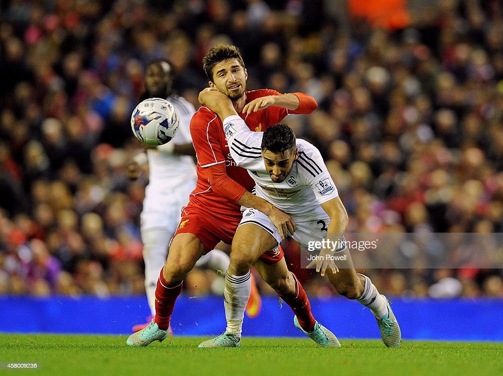 Fabio Borini of Liverpool tussles with Neil Taylor of Swansea City during the Capital One Cup Fourth Round match between Liverpool and Swansea City at Anfield on October 28, 2014 in Liverpool, England.