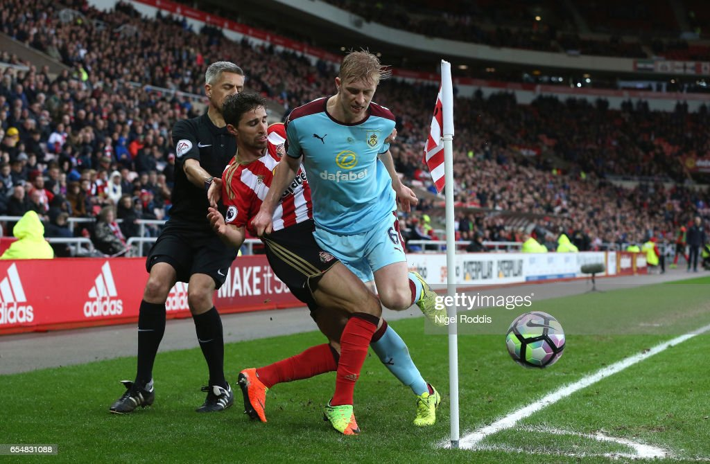 Fabio Borini of Sunderland (L) and Ben Mee of Burnley (R) battle for possession during the Premier League match between Sunderland and Burnley at Stadium of Light on March 18, 2017 in Sunderland, England.