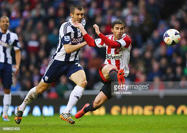 Fabio Borini of Sunderland beats Gareth McAuley of West Bromwich Albion to score their second goal during the Barclays Premier League match between...