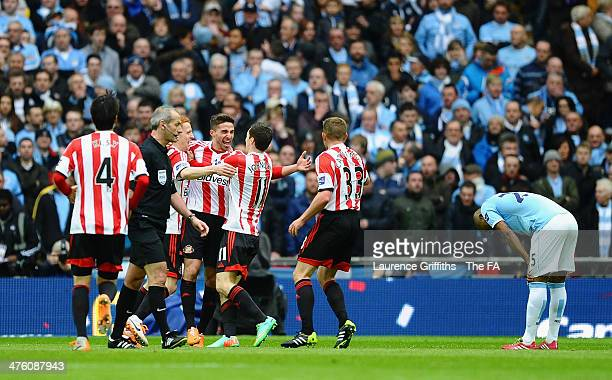 Fabio Borini of Sunderland celebrates scoring the opening goal with team mates during the Capital One Cup Final between Manchester City and...