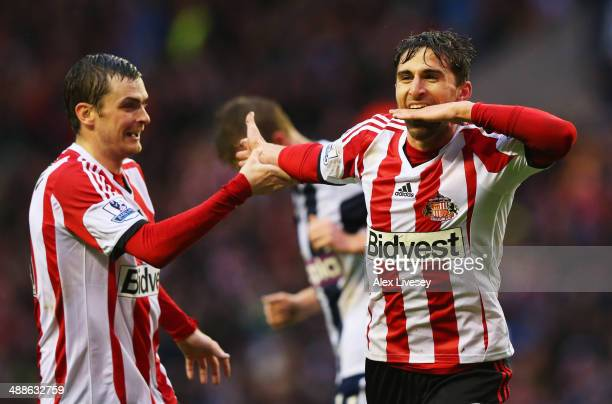 Fabio Borini of Sunderland celebrates with Adam Johnson as he scores their second goal during the Barclays Premier League match between Sunderland...