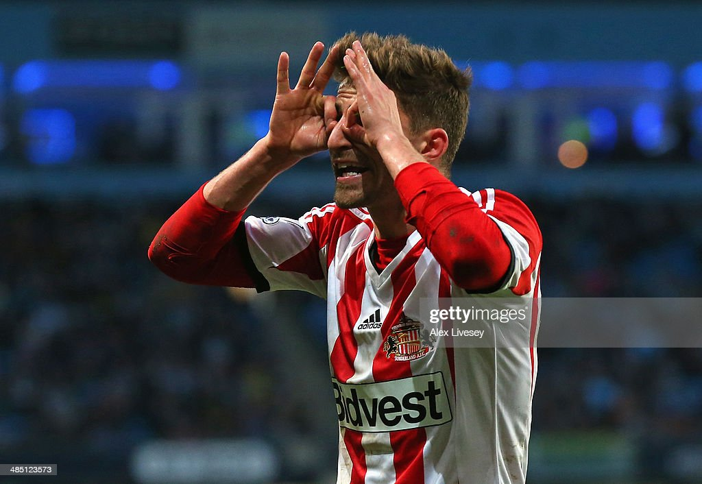 Fabio Borini of Sunderland gestures to the linesman during the Barclays Premier League match between Manchester City and Sunderland at Etihad Stadium on April 16, 2014 in Manchester, England.