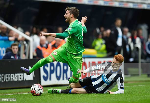 Fabio Borini of Sunderland is challenged by Jack Colback of Newcastle United during the Barclays Premier League match between Newcastle United and...