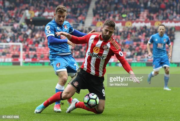 Fabio Borini of Sunderland is challenged by Ryan Fraser of AFC Bournemouth during the Premier League match between Sunderland and AFC Bournemouth at...