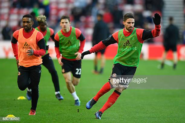 Fabio Borini of Sunderland runs through a drill with team mate Jermain Defoe prior to the Premier League match between Sunderland and Liverpool at...