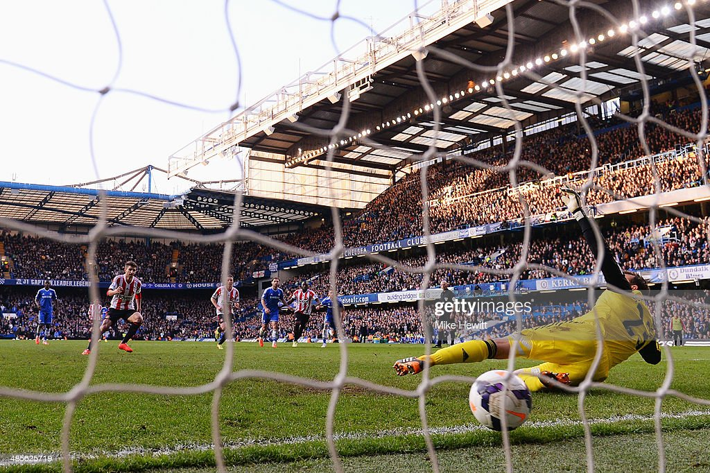 Fabio Borini (L) of Sunderland scores his sides second goal from the penalty spot past Mark Schwarzer the Chelsea goalkeeper during the Barclays Premier League match between Chelsea and Sunderland at Stamford Bridge on April 19, 2014 in London, England.