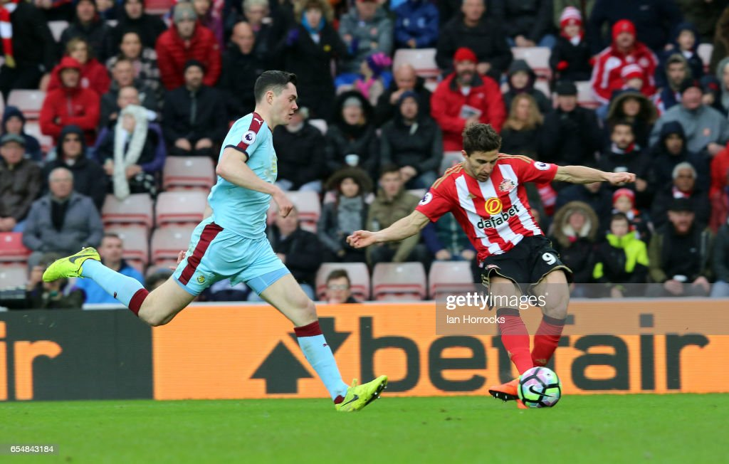 Fabio Borini of Sunderland (R) shoots on goal during the Premier League match between Sunderland and Burnley at Stadium of Light on March 18, 2017 in Sunderland, England.