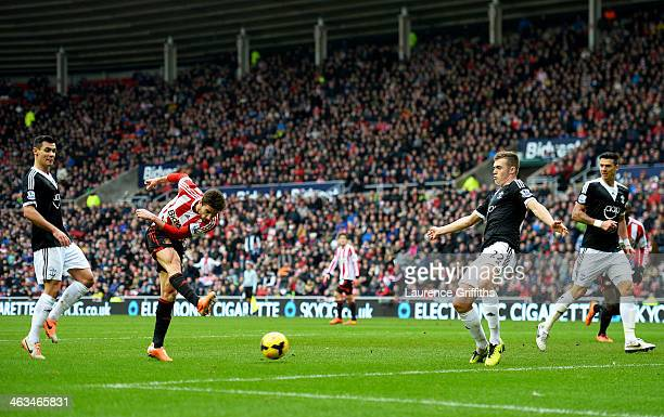 Fabio Borini of Sunderland shoots to scores their first goal during the Barclays Premier League match between Sunderland and Southampton at Stadium...