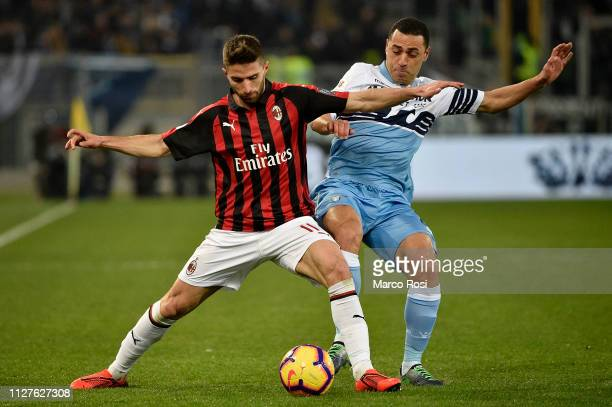 Fabio Borino of AC Milan competes for the ball with Romulo of SS Lazio during the Coppa Italia semifinal first leg between SS Lazio and AC Milan on...