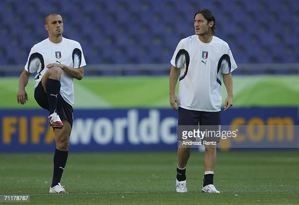 Fabio Cannavaro and Francesco Totti attend the Italy training session at the FIFA World Cup Stadium Hanover on June 11, 2006 in Hanover, Germany....