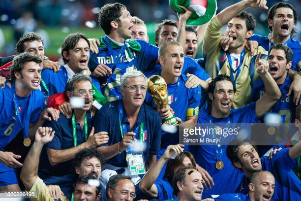 Fabio Cannavaro and Marcello Lippi coach of the Italian team with the World Cup Trophy. World Cup Final match between France and Italy . Italy would...
