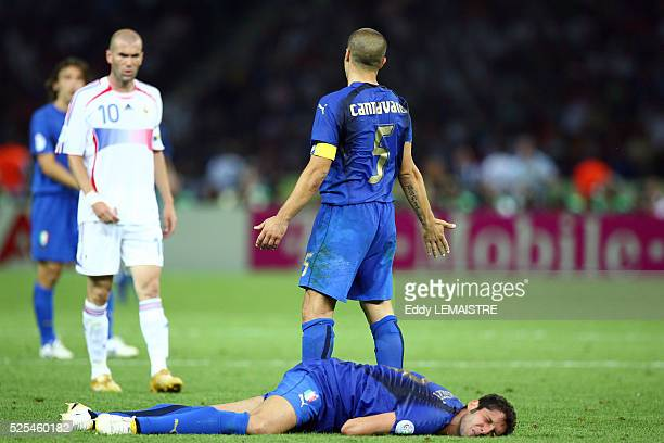 Fabio Cannavaro asks for an explanation as Marco Materazzi lies on the ground after receiving a head butt from Zinedine Zidane during the final of...