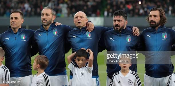 Fabio Cannavaro Gianluca Zambrotta Pietro Vierchowod Ivan Gennaro Gattuso and Andrea Pirlo line up for the anthem prior to the friendly match between...
