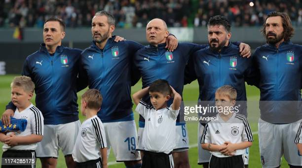 Fabio Cannavaro, Gianluca Zambrotta, Pietro Vierchowod, Ivan Gennaro Gattuso and Andrea Pirlo line up for the anthem prior to the friendly match...