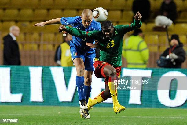 Fabio Cannavaro of Italy and Dorge Kouemaha of Cameroon compete for a header during the International Friendly match between Italy and Cameroon at...