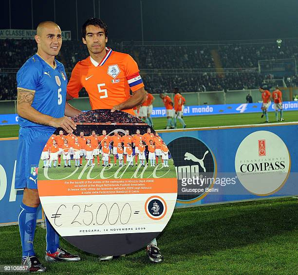 Fabio cannavaro of Italy and Giovanni van Bronckhorst of Holland in action during the International Friendly Match between Italy and Holland at...