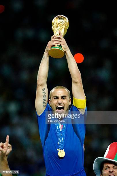 """Fabio Cannavaro of Italy celebrates at the end of the World Cup 2006 final match between Italy and France played at """"Olympic stadium"""" in Berlin on..."""
