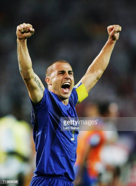 Fabio Cannavaro of Italy celebrates his team's victory at the end of the FIFA World Cup Germany 2006 Semi-final match between Germany and Italy...