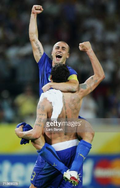 Fabio Cannavaro of Italy celebrates his team's victory with team mate Marco Materazzi at the end of the FIFA World Cup Germany 2006 Semi-final match...