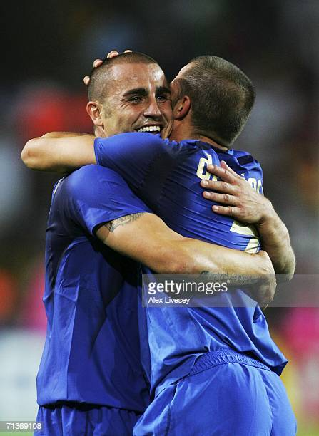 Fabio Cannavaro of Italy celebrates victory with team mate Alessandro Del Piero during the FIFA World Cup Germany 2006 Semifinal match between...