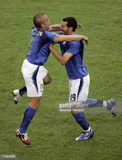 Fabio Cannavaro of Italy celebrates with teammate Gianluci Zambrotta following their team's 30 victory during the FIFA World Cup Germany 2006...