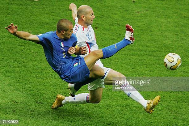 Fabio Cannavaro of Italy fights for the ball with Zinedine Zidane of France during the FIFA World Cup Germany 2006 Final match between Italy and...