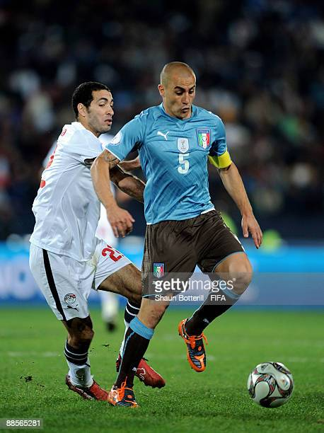 Fabio Cannavaro of Italy goes past Mohamed Aboutrika of Egypt during the FIFA Confederations Cup Group A match between Egypt and Italy at the Ellis...