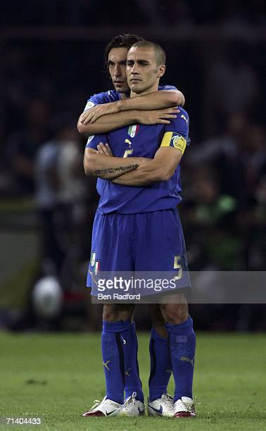 Fabio Cannavaro of Italy is hugged by teammate Andrea Pirlo as they watch the penalty shoot out during the FIFA World Cup Germany 2006 Final match...