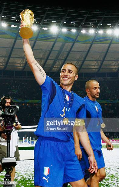 Fabio Cannavaro of Italy lifts the World Cup trophy aloft following victory in a penalty shootout at the end of the FIFA World Cup Germany 2006 Final...