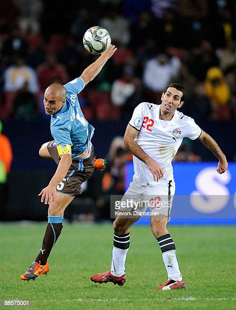 Fabio Cannavaro of Italy lunges for the ball with Mohamed Aboutrika of Egypt during the FIFA Confederations Cup between Italy and Egypt at Ellis Park...